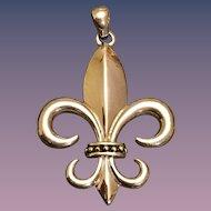 A classic 925 sterling g and 14k accent fleur-de-lis's pendant