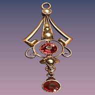 A dainty rose gold laviler pendant
