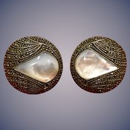 A classic pair of Judith Jack sterling marcascite mother of pearl circular omegaback earrings.