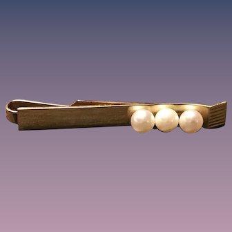 A vintage 14k mikimoto pearl tie clip