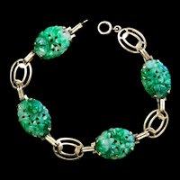 A vintage 1940-50s 14k Soret apple green jadeite bracelet.