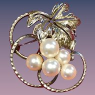 A vintage silver mikimoto pearl brooch.
