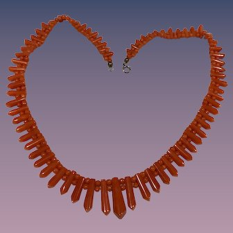 """A lovely Victorian era natrual graduated salmon coral """"picket and berries"""" necklace."""
