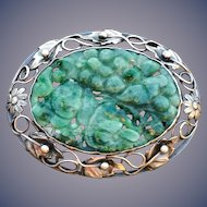 A beautiful vintage sterling carved jade pin.