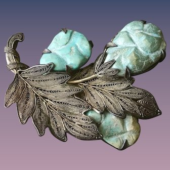 A huge and showy vintage Chinese silver carved turquoise silver filigree pin.