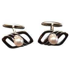 A classic pair of silver mikimoto pearl cufflinks