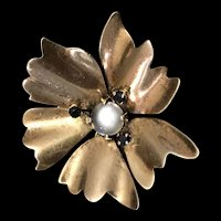 A retro 1940s  moonstone and sapphire floral pin.