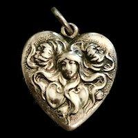 An adorable sterling art nouveau style charm.