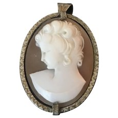 A finely carved vintage shell cameo set in 800 silver.