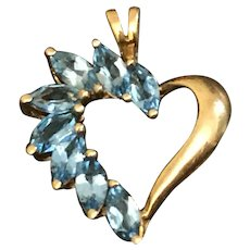 A classic 10k blue topaz heart pendant.