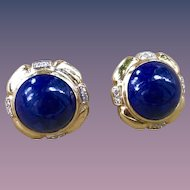 A showy pair of 14k diamond  accent and lapis post earrings.