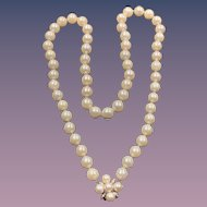 A lovely vintage cultured pearl necklace set with a 14k diamond and pearl clasp.