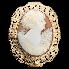 A lovely Art Deco 10k Otsby Barton  carved shell cameo pin/pendant.