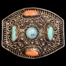 A lovely vintage Asian silver filigree coral, jade and turquoise pin.