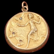 W and H Co,  graceful Art nouveau Lady and butterfly gold filled locket.