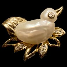 A sweet vintage 14k pearl and diamond pin.