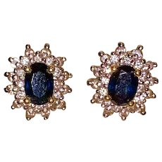 A pair of estate 14k sapphire and diamond stud earrings.
