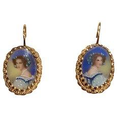 A pair of vintage 14k hand painted portrait earrings.