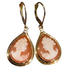 A classic pair of 14k carved shell cameo teardrop lever back earrings.