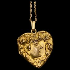 An art nouveau style gold filled pendant locket.