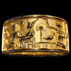 A fabulous Liz Taylor 22K gold plate Egyptian revival bracelet.
