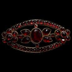 A pretty vintage bohemian garnet pin.