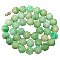 A fine quality 18k vibrant apple green jadeite beaded necklace.