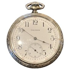 A white gold filled 17 jewel Waltham pocket watch.