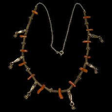 A vintage tribal silver salmon branch coral necklace.