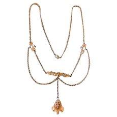 A charming vintage art nouveau gold plated festoon style necklace.