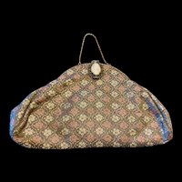 An elegant vintage silk evening purse set with a shell cameo closure