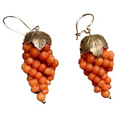 A classic pair of vintage gold gilt salmon coral grape earrings