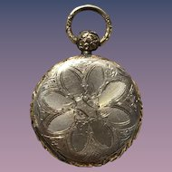 Victorian gold filled floral locket with picture inside.