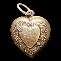A sweet vintage sterling puffy heart charm.