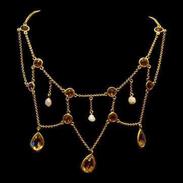 A lovely antique 10k gold citrine and pearl festoon necklace.