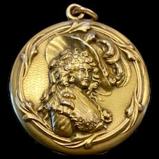 A classic vintage gold filled Victorian lady profile locket.
