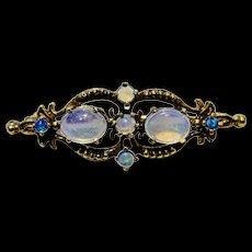 A fine vintage 14k jelly opal brooch.