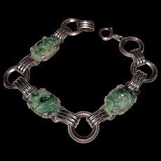 A stylish Art Deco sterling carved jade bracelet.