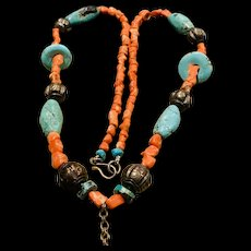A tribal/Asian coral turquoise silver necklace.