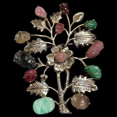 A large and showy vintage Chinese silver jade and gemstone pin.