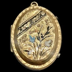 A sweet Victorian enamel gold filled locket.