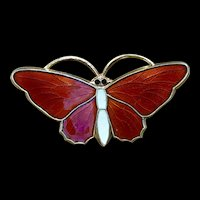 A classic Sterling red enamel Norwegian butterfly pin.