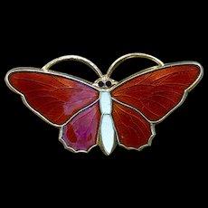 A classic Sterling red enamel Norwegian butterfly pin.