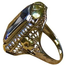 A vintage 14k two tone filigree seed pearl syn spinel ring