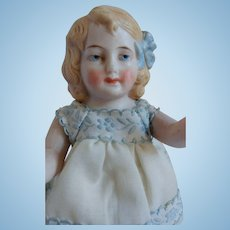 German All Bisque 5 Piece Doll With Molded Hair And Bow