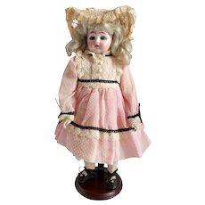 "Unique Ernst Heubach ""D"" Turned Shoulder Head Doll With Mechanical Mechanism"