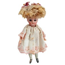 French Bisque Mignonette Doll With Swivel Head And Glass Eyes