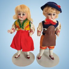 All Bisque All Original German Costumed With Swivel Head And Glass Eyes