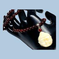 Buddha Head and Garnet Necklace