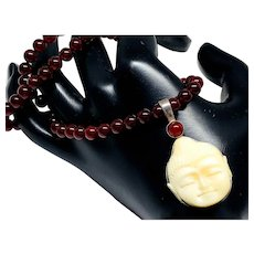 Buddha Head and Garnet Necklace